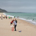 Beach cricket ….. over the Heads and you're out!!